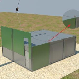 Ein Kranwagen platziert die Panzerplatten auf dem Dach der Container